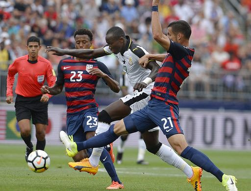 United States' Kellyn Acosta, left, and Matt Hedges, right, pressure Ghana's Raphael Dwamena, center, during the first half of an international friendly soccer match at Pratt & Whitney Stadium at Rentschler Field, Saturday, July 1, 2017, in East Hartford, Conn. (AP Photo/Jessica Hill)